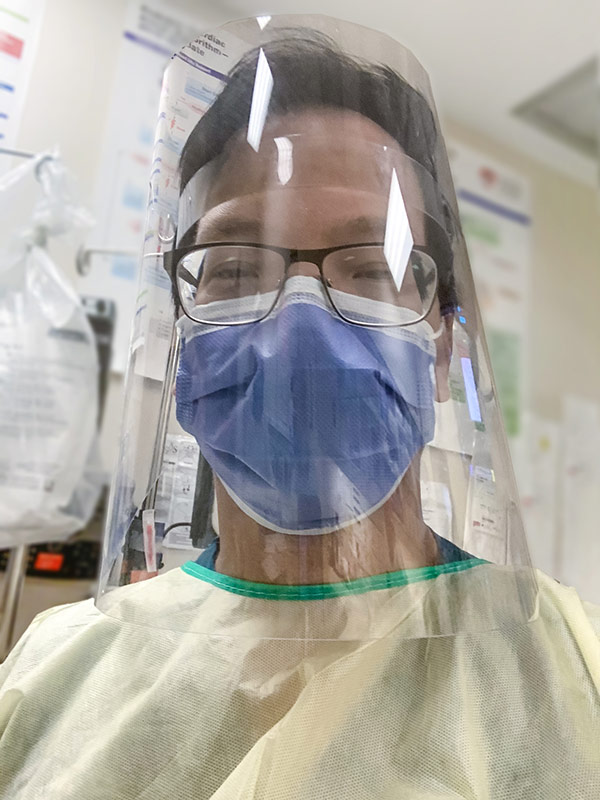 Doctor suited in gear to protect against COVID-19